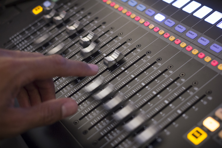 Picture of automatically moving mixing faders